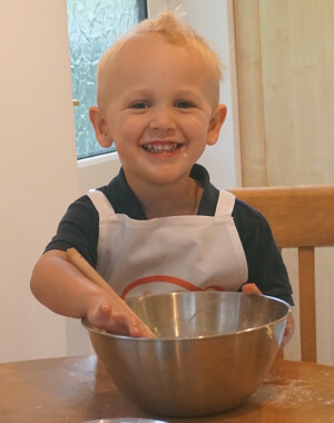 Dex baking in his apron